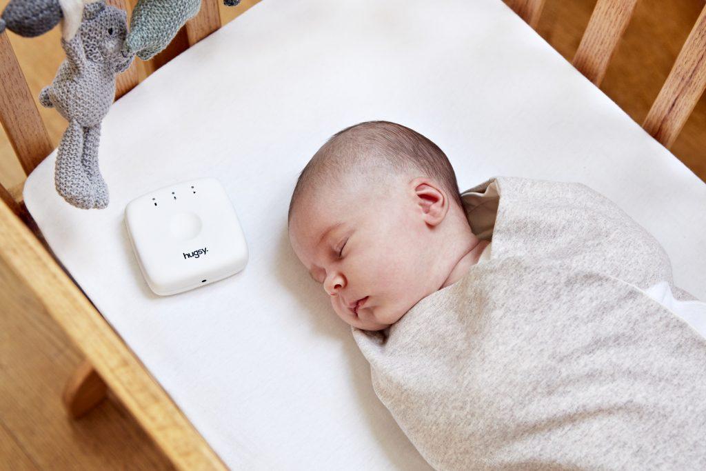 baby sleeping with Hugsy product
