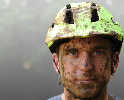 Man with mud on face and Hedkayse Helmet Sports Product Design Cycling Helmet