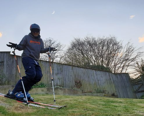 Skiing in the garden on grass