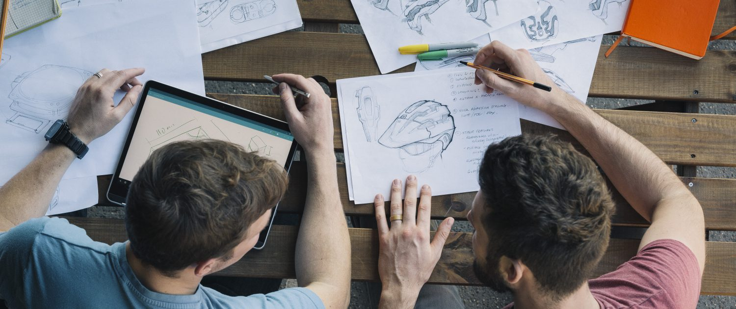 Product designers at work, sketching and developing concepts