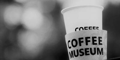 Paper coffee cup depicted as a museum artefact to represent the death of paper coffee cup packaging